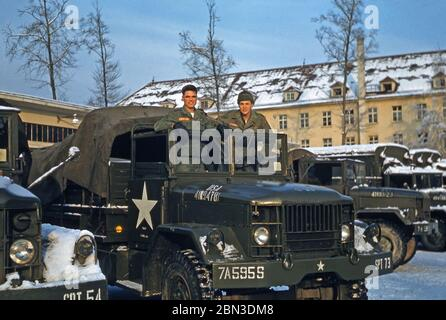 US Army soldiers stationed in Germany in the mid-1950s – two members of the 160th Signal Group are pictured on a military vehicle in the winter snow. From 1955 the 160th Signal Group provided communications throughout Germany under the US 7th (Seventh) Army during the Post-war era from an HQ at Panzer Kaserne (PK), in Böblingen (Boeblingen) near Stuttgart. The US 7th Army's HQ was at nearby Patch Barracks. - Stock Photo