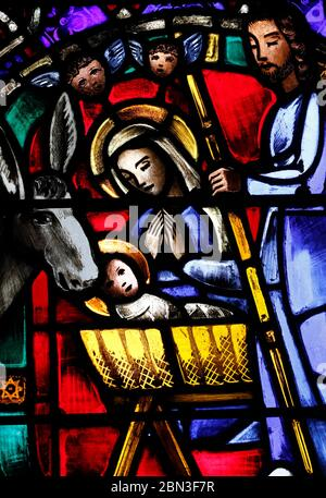 The American church in Paris. Stained Glass window depicting a Nativity Scene at Christmas.  France. - Stock Photo