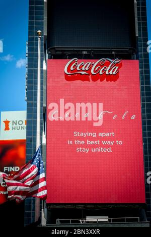 Coca-Cola uses their billboard for a public service announcement in an empty Times Square in New York because of the COVID-19 pandemic on Thursday, May 7, 2020.  (© Richard B. Levine) - Stock Photo