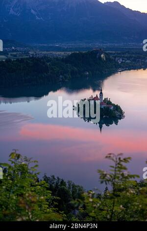 Beautiful view over Bled lake early in the morning. - Stock Photo