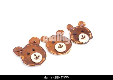 Flat lay composition with pancakes in form of bear isoleted on white background. Creative breakfast ideas for kids - Stock Photo