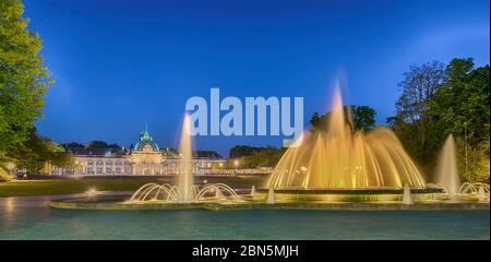 Spa garden with fountain, illuminated, Kaiserpalais, Bad Oeynhausen, Germany - Stock Photo