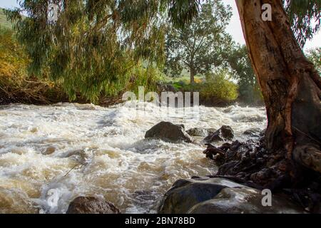 Israel, the Jordan river flows into the Sea of Galilee from the north and then from the Sea of Galilee to the Dead Sea - Stock Photo