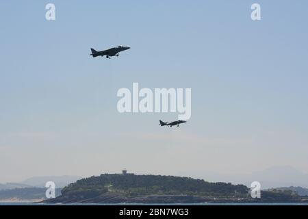 Series 106 of 165 Two McDonnell Douglas AV-8B Harrier II's hovering with the Magdalena Palace behind at Armed Forces Day - Stock Photo