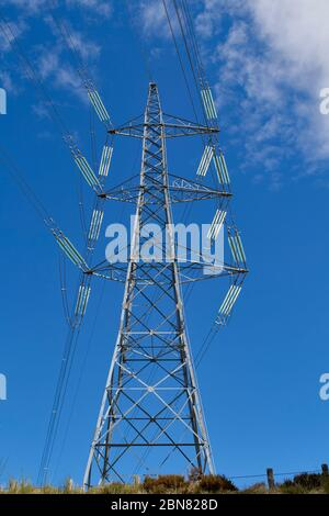 A transmission tower or power tower (alternatively electricity pylon or variations) is a tall structure, usually a steel lattice tower, used to suppor - Stock Photo