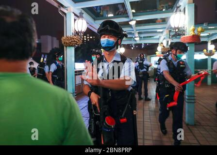 Police officers seen confronting with protesters during the protest.Pro-democracy protesters gather in different shopping malls on 13 May 2020, the day of Hong Kong chief executive Carrie Lam birthday. They demand investigation for the brutality actions carried out to the protesters by the Hong Kong police during last year's protests triggered by the extradition bill. - Stock Photo