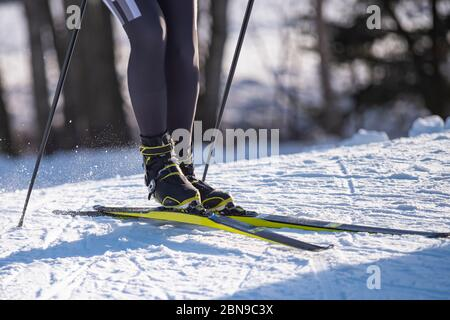 Detail of nordic ski skier on a slope - Stock Photo
