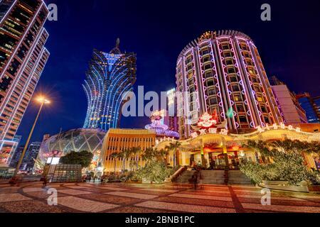 Hotels Lisboa and Grand Lisboa illuminated at night. Macau, China. Stock Photo
