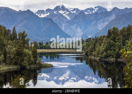 The 'View of Views' - Lake Matheson looking towards Mount Tasman and Mount Cook, Fox Glacier, South Island, New Zealand