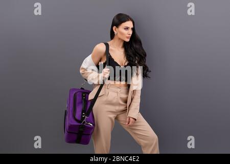 Full length body size view of nice attractive cheerful lady with big case traveling abroad resort on grey background - Stock Photo