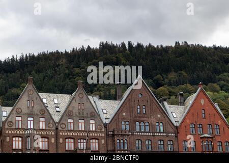 Bergen city street, Norway. Houses in Hanseviertel Bryggen medieval wharf in historic harbour district. Colourful, wooden-clad boat houses UNESCO Worl