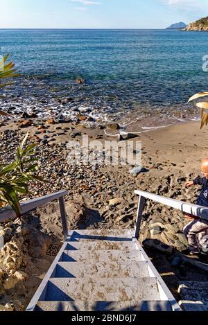 Landscape of Bathing beach Porto Frailis on the rocky coast of Sardinia - Arbatax, Tortol, Ogliastra, Italy - 19th of May 2919 - Stock Photo