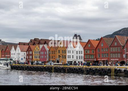 Sea water view on historical buildings in Hanseviertel Bryggen wharf in Bergen, Norway. UNESCO World Heritage Site