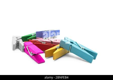 Colorful wooden clothespins isolated on the white background. - Stock Photo