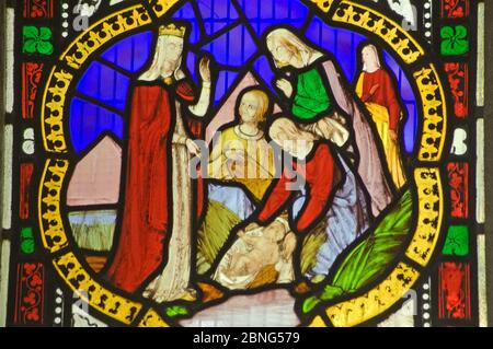 A Victorian stained glass window depicting the baby Moses being discovered in his basket amid bullrushes on the River Nile by the Princess daughter of - Stock Photo