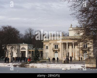 Frozen lake in front of palace on the isle in baths park in Warsaw european capital city at Masovian Voivodeship, Poland, cloudy sky in 2019 cold wint - Stock Photo