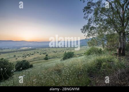 Sunset view of the slopes of the Golan Heights, and the Hula Valley. Northern Israel - Stock Photo