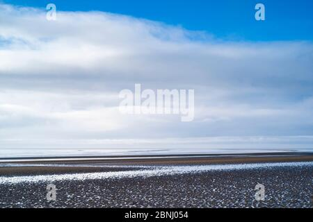 Pastel shades of sea and sandy beach of the Bristol Channel at Burnham-on-Sea seashore, Somerset, UK