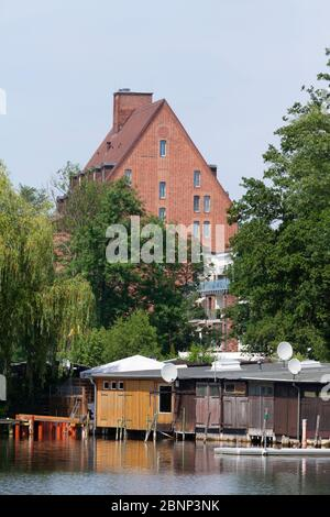Hotel Speicher and boathouses on Ziegelsee, Schwerin, Mecklenburg-West Pomerania, Germany, Europe - Stock Photo