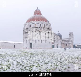 Baptistery, Cathedral and Leaning Tower in a snowy day, Pisa, Tuscany, Italy, Europe - Stock Photo