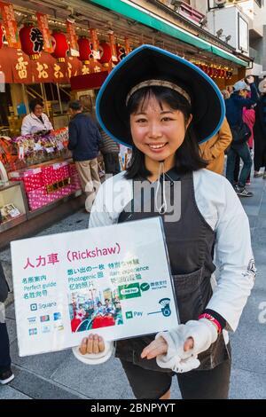 Japan, Honshu, Tokyo, Asakusa, Female Rickshaw Puller dressed in Traditional Costume - Stock Photo
