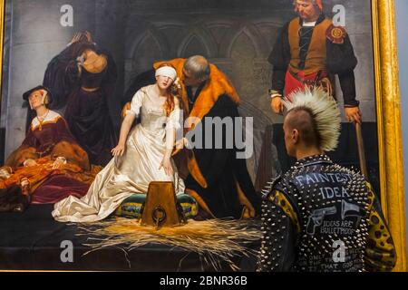 England, London, Trafalgar Square, The National Gallery, Punk Visitor in Front of Painting  titled 'Execution of Lady Jane Grey' by Paul Delaroche - Stock Photo