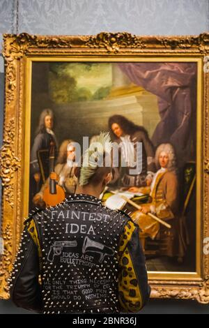 England, London, Trafalgar Square, The National Gallery, Punk Visitor in Front of Painting - Stock Photo