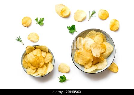 Potato chips in bowls isolated on white background. Homemade oven baked crispy potato chips, top view, copy space. - Stock Photo