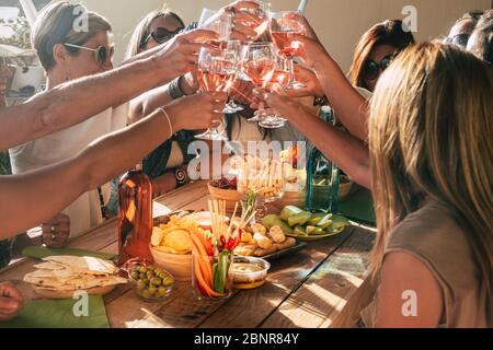 Group of happy and cheerful caucasian people women have fun all together drinking and toasting with red wine - friendship and holiday celebration concept with adult females - Stock Photo