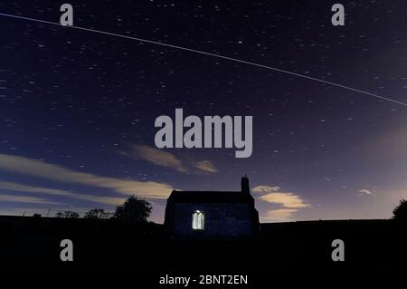 St Mary's Chapel near Tadcaster with a pass from the International Space Station - Stock Photo