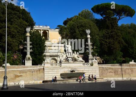 Piazza del Popolo with the Fontana della Dea di Roma, looking up at the Baclonata del Pincio in the city of Rome, Italy - Stock Photo