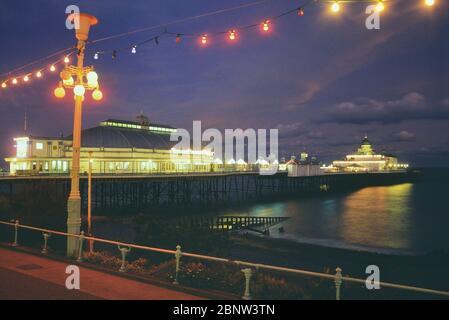 Eastbourne pier at dusk, East Sussex, England, UK - Stock Photo