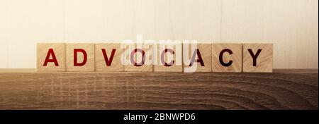 Advocacy Word on Wooden Cubes. Law, conflict solution and business regulation concept