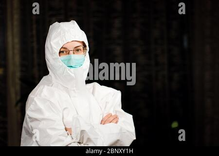 Healthcare doctor in protective medical suit and surgical mask - Stock Photo