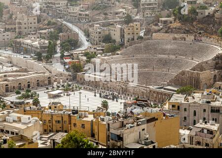 View of the ruins of an ancient Roman amphitheatre in the city of Amman in Jordan - Stock Photo