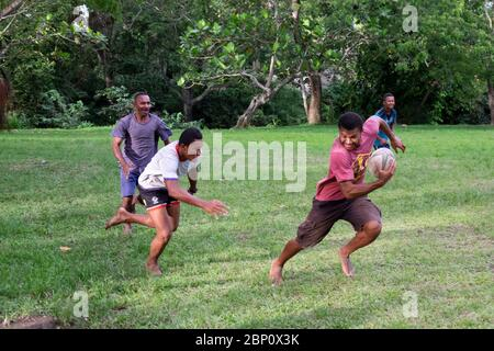 Fijian men play rugby in the local park in Sigatoka (Singatoka), Fiji. - Stock Photo