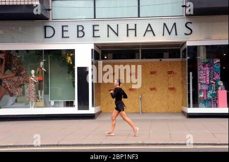 London, UK. 17th May, 2020. Debenhams boarded up in Oxford street after going bankrupt. Oxford street without shoppers on Sunday during coronavirus covid-19 lockdown as shops remain closed. Credit: JOHNNY ARMSTEAD/Alamy Live News
