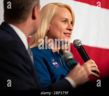 Artemis Generation Spacesuit Event  NASA astronaut Kate Rubins answers an audience question during a panel discussion with NASA Administrator Jim Bridenstine and Chris Hansen, Manager of the Extravehicular Activity office at NASA's Johnson Space Center during the Artemis Generation Spacesuit event, Tuesday, Oct. 15, 2019 at NASA Headquarters in Washington. The Exploration Extravehicular Mobility Unit (xEMU) suit improves on the suits previous worn on the Moon during the Apollo era and those currently in use for spacewalks outside the International Space Station and will be worn by first woman - Stock Photo