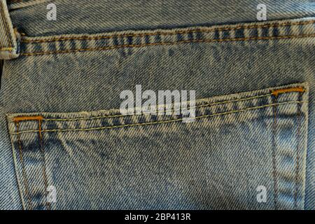 Blue jeans back large pocket close-up. Denim texture macro photo. Background with copy space. - Stock Photo
