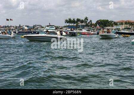 Boats pack the intercoastal waterway as people celebrate the start of summer and Memorial Day in Ft. Lauderdale, Florida on May 26, 2019. - Stock Photo