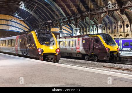 2 Arriva Crossountry trains Bombardier diesel voyager trains under the station roof at York railway station - Stock Photo