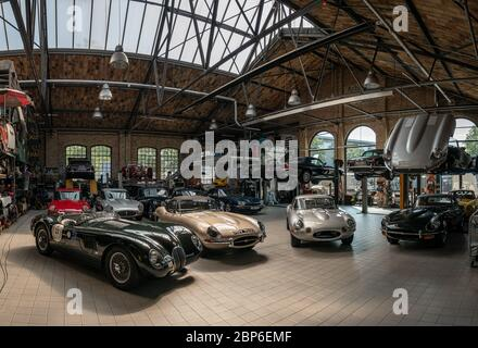 BERLIN - MAY 11, 2019: Panoramic view of the workshop for the repair and maintenance of English classic retro cars. 32th Berlin-Brandenburg Oldtimer Day. - Stock Photo