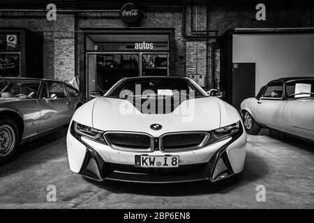 BERLIN - MAY 11, 2019: Plug-in hybrid sports car BMW i8. Black and white. 32th Berlin-Brandenburg Oldtimer Day. - Stock Photo