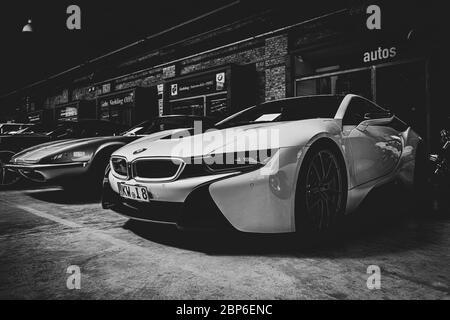 BERLIN - MAY 11, 2019: Plug-in hybrid sports car BMW i8. Black and white, stylization. 32th Berlin-Brandenburg Oldtimer Day. - Stock Photo