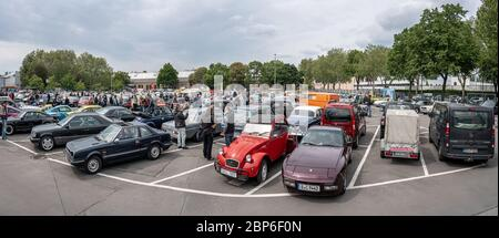 BERLIN - MAY 11, 2019: Panoramic view of the parking with various standing oldtimer and youngtimer. 32th Berlin-Brandenburg Oldtimer Day. - Stock Photo