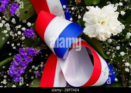 Spray of flowers, miliary memorial, Inimond, Bugey massif, Ain, France - Stock Photo