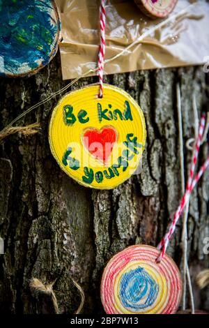 On Sunday 17th May, 2020, I discovered this 'Positivity Tree' filled with messages of hope, love, and support during this difficult time. - Stock Photo
