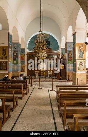 Jordan, Madaba, The nave and iconostasis in St. Georges Church, a Greek Orthodox church. The famous Madaba Map of the Holy Land, circa 560 A.D., is surrounded by the chains. - Stock Photo