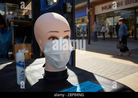 A mannequin head with face mask on a London market stall selling face masks and hand sanitiser. First week market opened after lockdown eased in UK. - Stock Photo