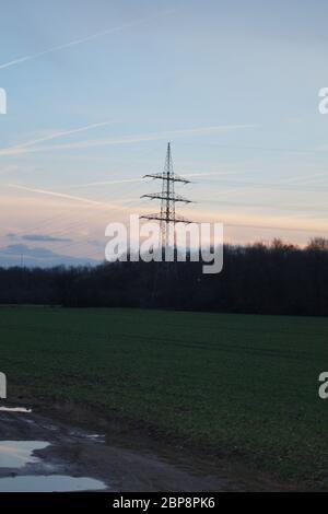 Stromleitungen an einem Sommerabend nahe Bonn - Stock Photo
